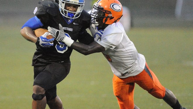 Murrah's Malik Dear, left, fights for yardage as Callaway's David Hudson tries to make the tackle last season at Newell Field in Jackson.