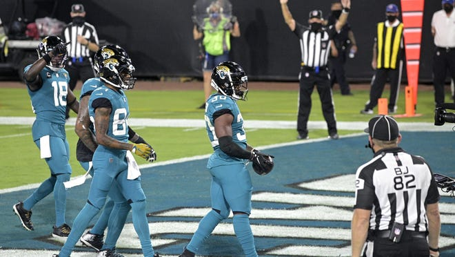 Jacksonville Jaguars running back James Robinson (30) walks through the end zone after rushing for a touchdown against the Miami Dolphins on Thursday, Sept. 24, 2020, in Jacksonville, Florida. Robinson had two rushing TDs in the game.