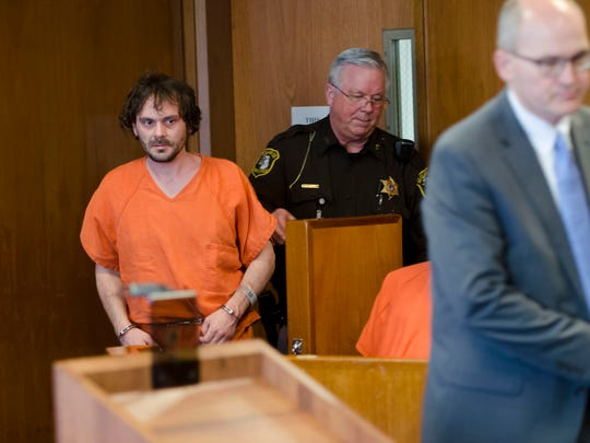Matthew Lander is guided to the stand as he follows his lawyer, Frederick Lepley Tuesday, March 21 for a hearling in front of visiting Judge Russell Etheridge in 72nd District Court in Port Huron. Lander is charged with two counts of assault with intent to commit murder.