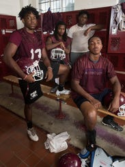 De'Andre Thurman left, Deaaron Finklee, left center,