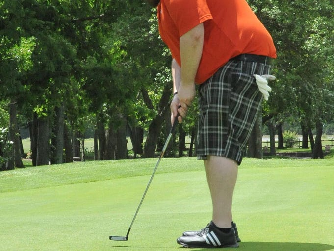 Lee Magann, of Hammonton, lines up a short putt at the Latona Country Club on  Saturday, May 31, 2014.  Staff photo/Charles J. Olson