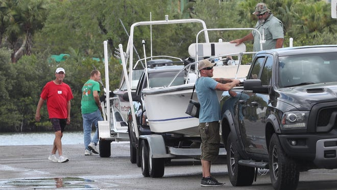 Boaters stow their gear after pulling their craft out of the water at the North Causeway Boat Ramp back in March, before the city shuttered the ramps over COVID-19 concerns. The city reopened them April 17 and since then has seen an uptick in illegally parked trailers. The City Commission this week agreed to hike the fines from $36 to $100.