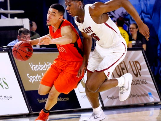 Blackman'sTrent Gibson (33) brings the ball down the