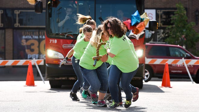 The team from Mahowald Insurance Agency took the rope to pull a bus in the New Flyer Annual United Way Community Bus Pull Thursday, Aug. 24, in St. Cloud.