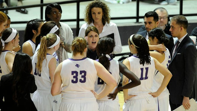 Abilene Christian head coach Julie Goodenough (center) talks to her player during a timeout in the fourth quarter of the Wildcats' 83-76 win on Saturday, Jan. 7, 2016, at ACU's Moody Coliseum.