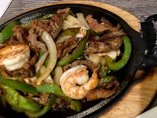 The shrimp and steak fajitas at La Catrina are made