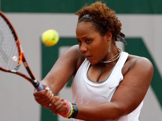 Taylor Townsend, of the U.S, returns the ball to France's Alize Cornet during the second round match of  the French Open tennis tournament at the Roland Garros stadium, in Paris, France, Wednesday, May 28, 2014. (AP Photo/Darko Vojinovic)