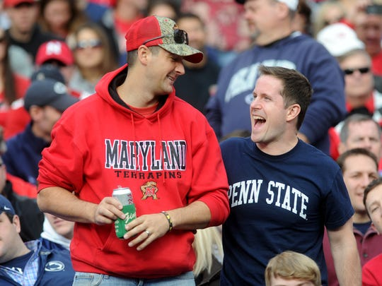 PSU and University of Maryland fans, joke around during the Nittany Lions' 31-30 victory over Maryland in Baltimore on Saturday, Oct 24, 2015.