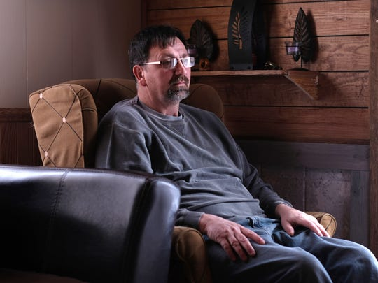 Jim Hall in his home in St. Louis on Wednesday, March 7, 2018. Hall grew up near the factory involved in the PBB disaster of the 1970s and has PBB blood levels multiple times higher than even former factory workers. He has exhibited some of the health problems Emory researchers have tied to the exposures, including having to have his thyroid removed.