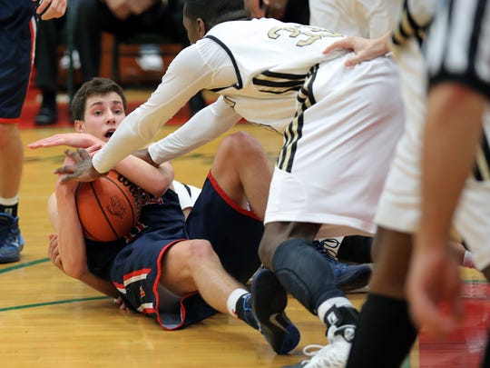 Roncalli's Jimmy King tries to call time out while he and Warren Central defenders fight for the ball.