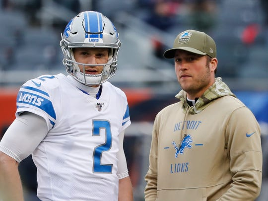 Lions quarterbacks Jeff Driskel and Matthew Stafford during warmups in Chicago, Sunday.