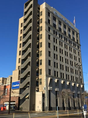 The century old Capital One Building in downtown Alexandria has been sold.
