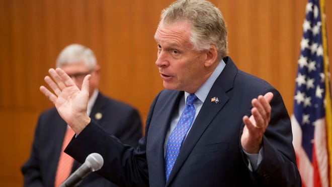 Virginia Governor Terry McAuliffe talked to reporters about the state's budget shortfall earlier this month.