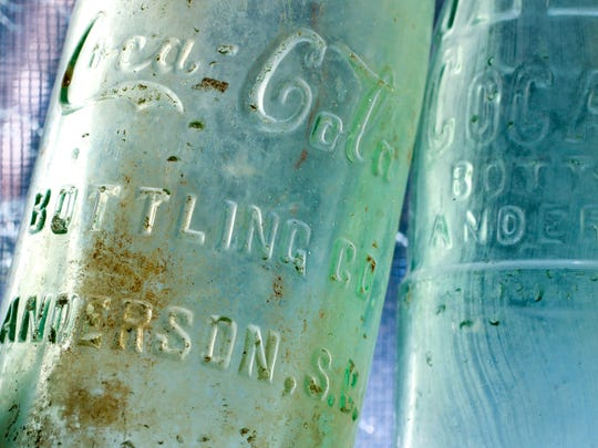 These Coca-Cola bottles, without paint and embossed, from around 1895-1910, came from Anderson bottling plants.