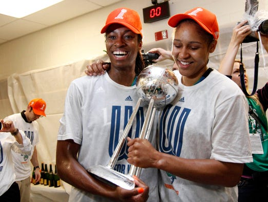 Minnesota Lynx forward Devereaux Peters (14) and forward Maya Moore (23) celebrate a victory against the Atlanta Dream at the Arena at Gwinnett Center. The Lynx defeated the Dream 86-77 to win the WNBA Championship.