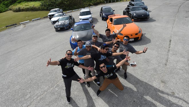 Team Exile poses for a picture in front of their cars during a photo shoot at the War in the Pacific National Historical Park in Asan on March 8, 2017.