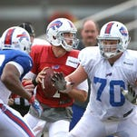 Bills center Eric Wood (70) drops back in pass coverage to protect QB Kevin Kolb from the pressure of Keith Pough (49).