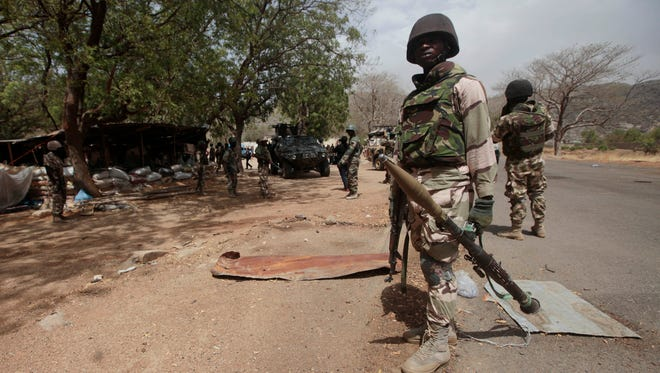 Nigerian soldiers man a checkpoint in Gwoza, Nigeria, a town newly liberated from Boko Haram.