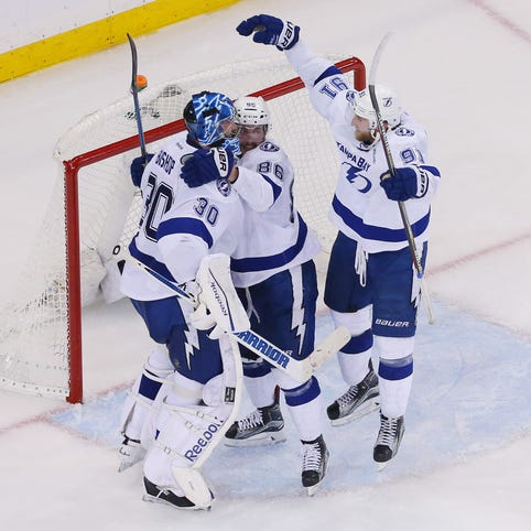 Tampa Bay Lightning center Alex Killorn (17) celebrates with teammates Steven Stamkos (91) and Valtteri Filppula (51) after scoring a goal as New York Rangers defenseman Dan Boyle (22) skates away during the third period of Game 7 at Madison Square Garden.