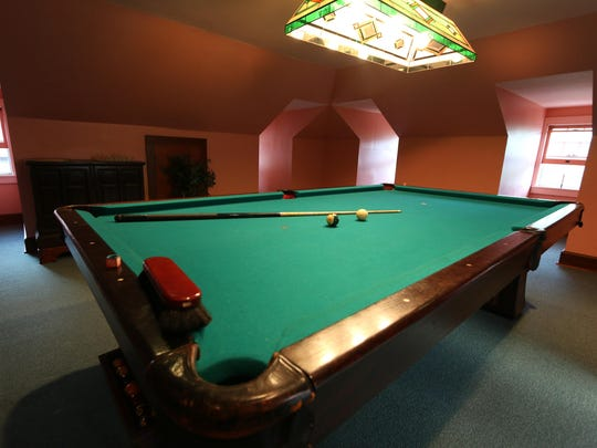 A pool table from 1912 is one of the features in the