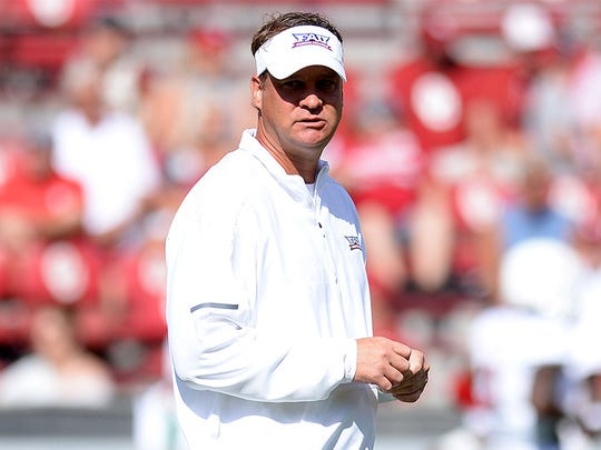 Florida Atlantic coach Lane Kiffin watches his team warm up prior to their game against Oklahoma.