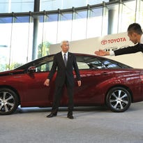 "In this 2014 photo, Toyota Motor Corp. Executive Vice President Mitsuhisa Kato, left, is escorted after a photo session in Tokyo. The world's top-selling automaker outlined a new ""architecture"" Thursday centered on product development and manufacturing initiatives it hopes will be more fail-proof against quality problems and allow it to keep growing."