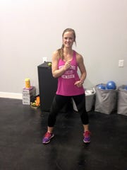 Samantha Robbins, owner and lead instructor at Crossroads Fitness Studio & Boutique in Powell, puts a class through the paces.