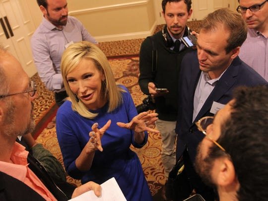 Paula White talks to reporters at the Religion News Association conference in Nashville on Saturday morning.