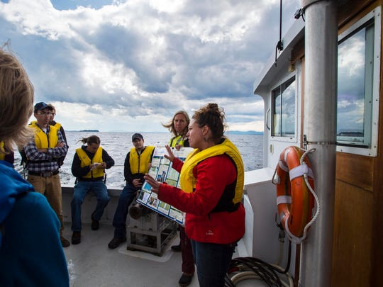 "Danielle Garneau, an associate professor of environmental science at SUNY Plattsburgh's Center for Earth and Environmental Science, right, explains her research on the prevalence of micro-plastics in Lake Champlain to a group of storm and waste water professionals on the University of Vermont's research ship ""Melosira"" on Lake Champlain on Thursday, September 7, 2017."