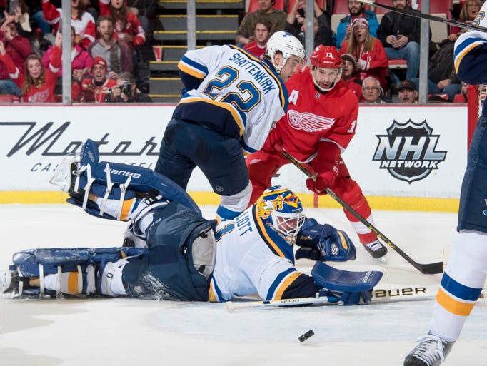 Detroit center Pavel Datsyuk tries to get the puck