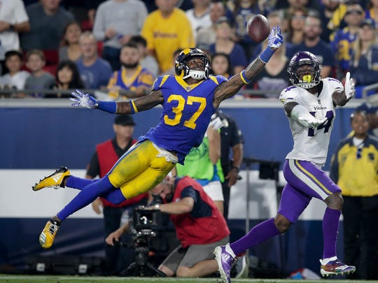 Los Angeles Rams defensive back Sam Shields breaks up a pass intended for Minnesota Vikings wide receiver Stefon Diggs during the first half in an NFL football game Thursday, Sept. 27, 2018
