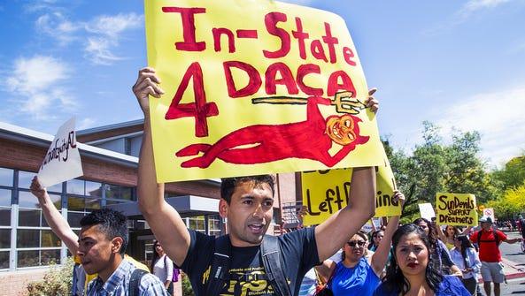 Arizona State University students walk on the Tempe
