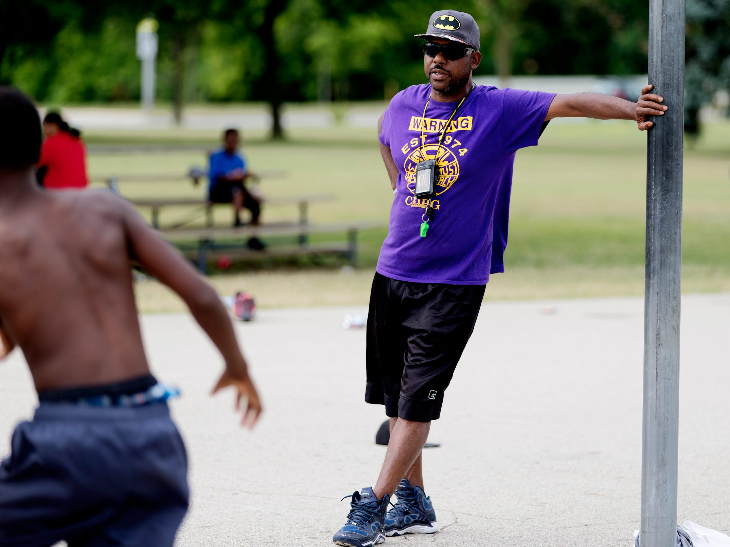 Eric Moore, 48, coaches practice at Meaux Park in Milwaukee.