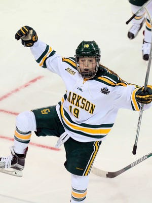 Clarkson forward Loren Gabel reacts after scoring in the second period during an NCAA college Division I Women's Frozen Four semifinal against Minnesota, Friday, March 17, 2017, in St. Charles, Mo.