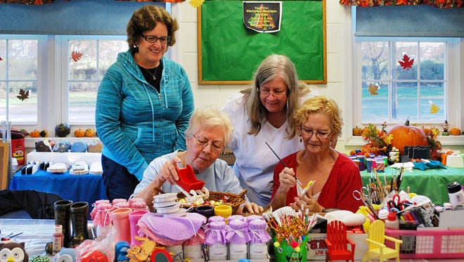 Volunteers create items for Bunker Hill Presbyterian Church's Christmas Boutique for Kids.