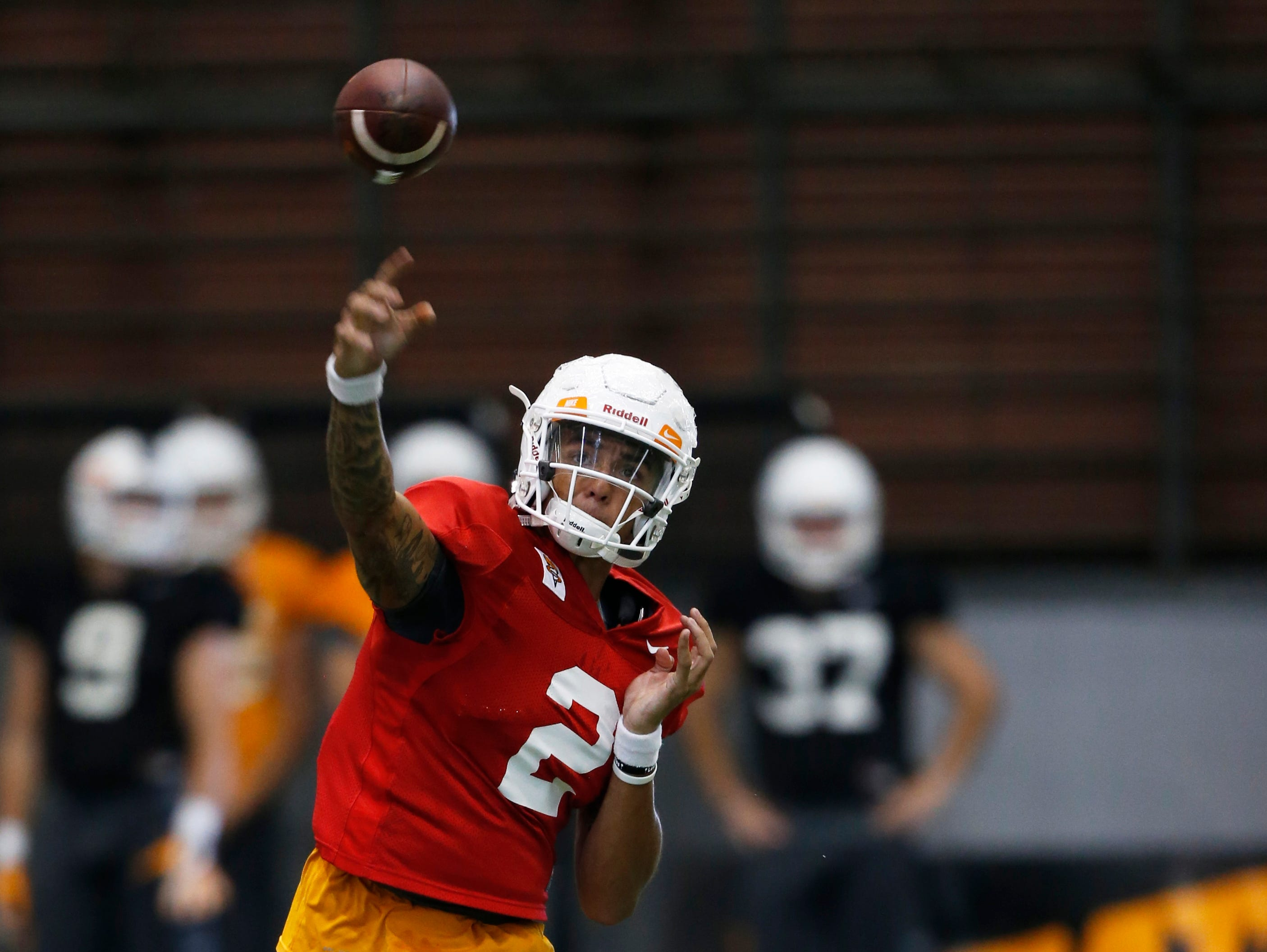 Quarterback Jarrett Guarantano throws to a receiver during practice Thursday, Aug. 31, 2017, in Knoxville, Tenn.