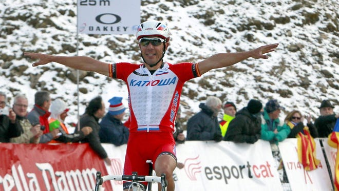 Spanish cyclist Joaquim 'Purito' Rodriguez of Katusha team celebrates as he wins the third stage of the Volta Ciclista a Catalunya, 162.9 km between Banyoles and La Molina, Spain on Wednesday.