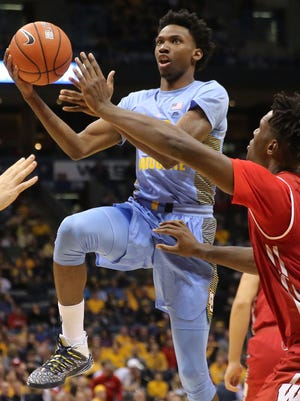 Marquette's Jujuan Johnson goes for the basket as Nigel Hayes tries to defend.
