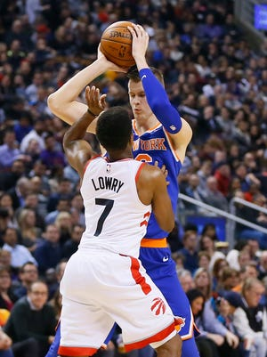 Toronto Raptors guard Kyle Lowry (7) defends against Knicks forward Kristaps Porzingis (6) during the first half at the Air Canada Centre on Friday night., Nov. 17, 2017.