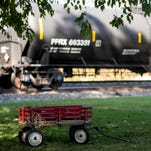 A child's wagon sits in a yard on Oct. 21 near tanker cars that are parked on a Norfolk Southern railroad track that runs past Cleona Borough.