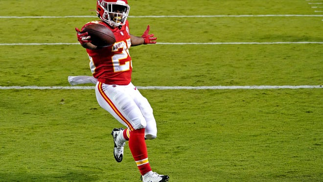 Kansas City Chiefs running back Clyde Edwards-Helaire (25) celebrates scoring a touchdown during the second half against the Houston Texans at Arrowhead Stadium.