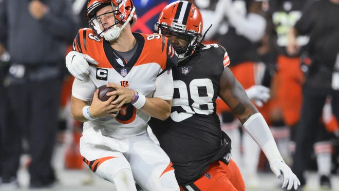 Browns defensive tackle Sheldon Richardson sacks Bengals quarterback Joe Burrow during the first half, Thursday, Sept. 17, 2020, in Cleveland.