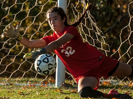 Rice keeper #32 Hannah Miller saves a shot on goal during Wednesday night's girls soccer game against Milton. Miller would be tested over and over, denying Milton for most of the game.