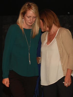 Shannon Jackson and Lindsay McMilllan share a moment after accepting the Citizen of the Year award from the Gallatin News Examiner in honor of their father, Dr. Jerry McMillan, Thursday, Oct. 20 at The Palace Theatre.