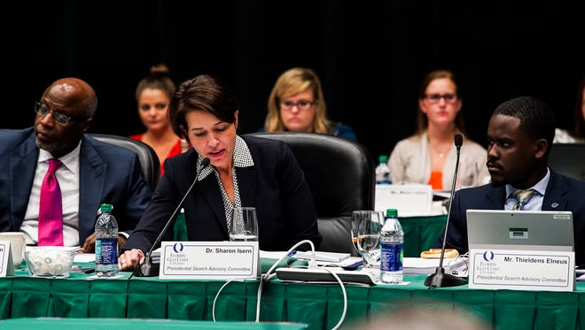 Sharon Isern, a professor at Florida Gulf Coast University, asks a question of former state Rep. Tom Grady as he interviewed Wednesday for the president's job at FGCU. Grady is one of nine candidates interviewing for the position.