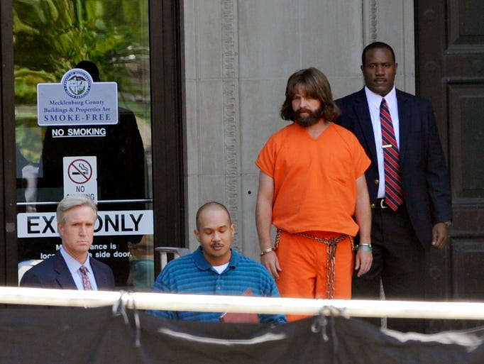 Zach Galifianakis and other actors prepare for a scene as crews film at the Buncombe County Courthouse in downtown Asheville Tuesday. The film, to be released in 2015, is an action comedy directed by Jared Hess and starring Zach Galifianakis, Owen Wilson and Kristen Wiig. 7/29/14. Robert Bradley (rbradley@citizen-times.com)