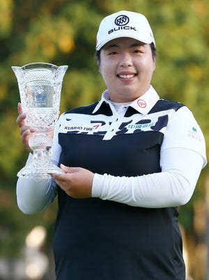 Shanshan Feng poses with the trophy after winning the LPGA Japan Classic.
