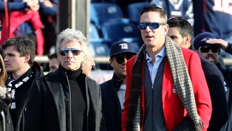 Jon Bon Jovi and former New England Patriots quarterback Drew Bledsoe look on before the AFC Championship Game between the New England Patriots and the Jacksonville Jaguars at Gillette Stadium on January 21, 2018 in Foxborough, Massachusetts.