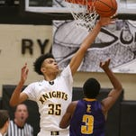 McQuaid's Cam Wilson (35) gets a piece of this shot by East's Zion Morrison (3).  McQuaid went on to win 70-56.