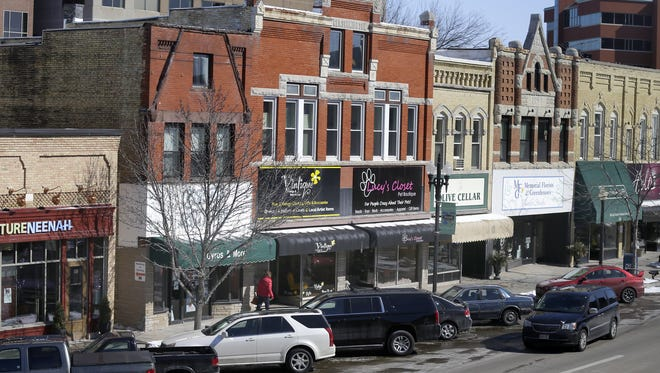 Downtown Neenah's west end merchants have seen slower traffic since the Dec. 5 hostage and shooting incident.